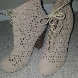 Preforated tan lace up booties